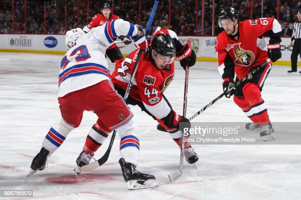 JeanGabriel Pageau of the Ottawa Senators takes a faceoff against Brandon Pirri of the New York Rangers as Mark Stone of the Ottawa Senators looks on...