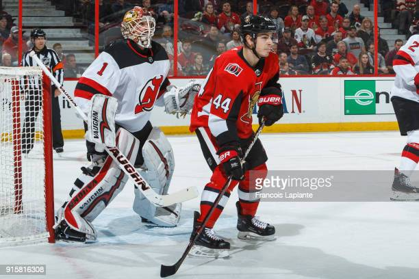 JeanGabriel Pageau of the Ottawa Senators takes position at the net as Keith Kinkaid of the New Jersey Devils defends at Canadian Tire Centre on...