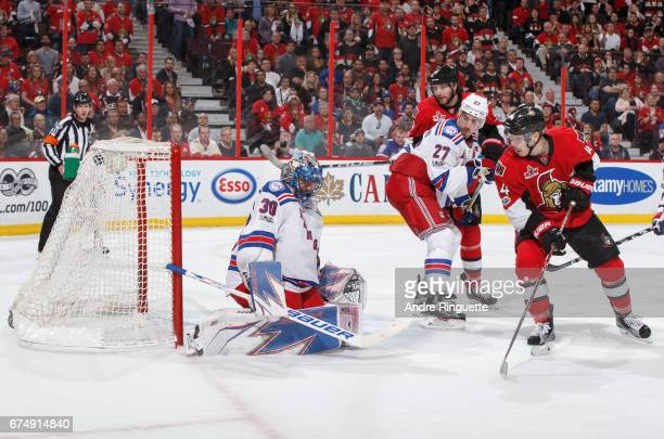 Jean-Gabriel Pageau of the Ottawa Senators tips the puck past Henrik Lundqvist of the New York Rangers for a last minute, game-tying hat-trick goal...