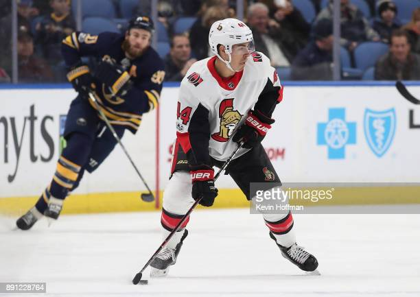 JeanGabriel Pageau of the Ottawa Senators with the puck as Ryan O'Reilly of the Buffalo Sabres pursues during the first period at the KeyBank Center...