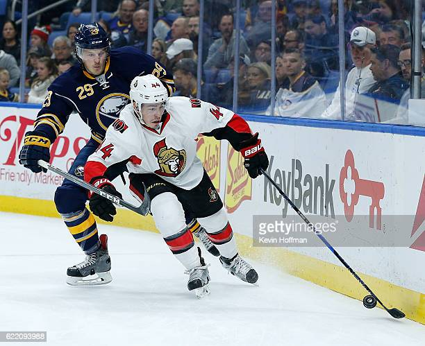 JeanGabriel Pageau of the Ottawa Senators with the puck behind the net as Jake McCabe of the Buffalo Sabres pursues during the first period at the...
