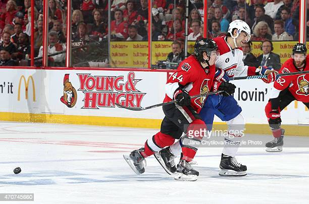 JeanGabriel Pageau of the Ottawa Senators xchecks Max Pacioretty of the Montreal Canadiens in Game Four of the Eastern Conference Quarterfinals...
