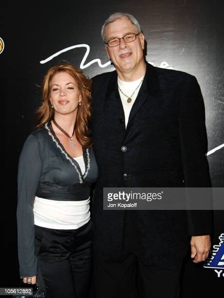 Jeanie Buss and Phil Jackson during The 3rd Annual Lakers Casino Night Arrivals at Barker Hangar in Santa Monica California United States