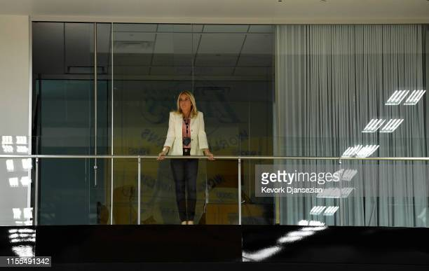 Jeanie Buss controlling owner and president of the Los Angeles Lakers looks from a balcony before the start of a news conference where Anthony Davis...