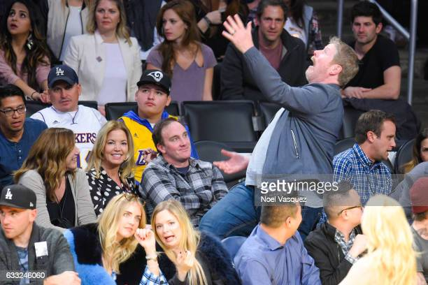Jeanie Buss Jay Mohr and John DiMaggio attend a basketball game between the Denver Nuggets and the Los Angeles Lakers at Staples Center on January 31...