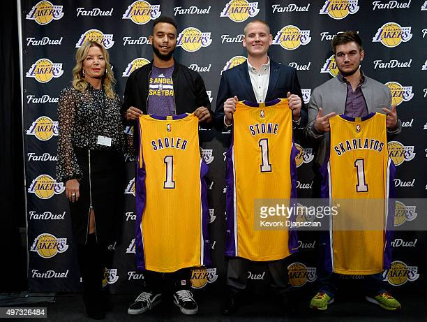 Jeanie Buss partowner and president of the Los Angeles Lakers poses with Anthony Sadler Airman 1st Class Spencer Stone US Army Specialist Alek...