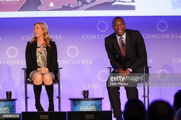 Jeanie Buss President of the Los Angeles Lakers and NBA Cares Global Ambassador Dikembe Mutombo attends the 2014 Concordia Summit at the Grand Hyatt...