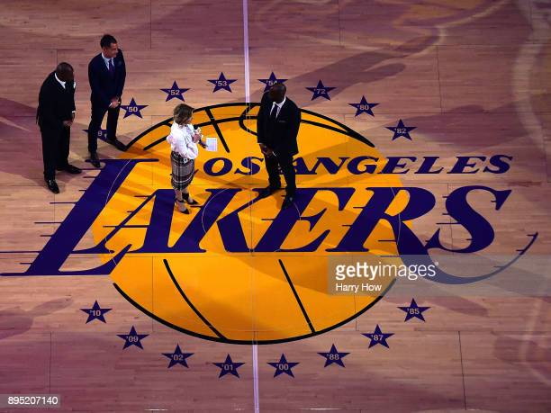 Jeanie Buss speaks to Kobe Bryant at Bryant's jersey retirement ceremony during halftime of a basketball game between the Los Angeles Lakers and the...