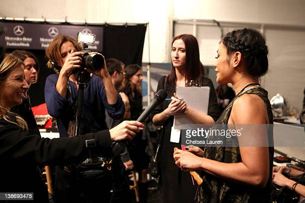 Jeanie Syfu speaks backstage at the Charlotte Ronson Fall 2012 fashion show during MercedesBenz Fashion Week at The Stage at Lincoln Center on...