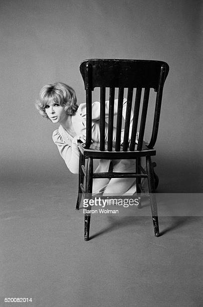 Jeanie The Tailor poses with a chair in Los Angeles 1968