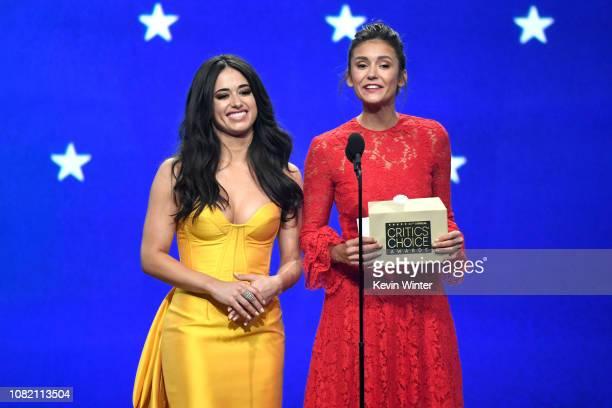 Jeanine Mason and Nina Dobrev speak onstage during the 24th annual Critics' Choice Awards at Barker Hangar on January 13 2019 in Santa Monica...