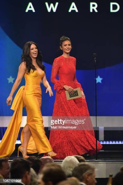 Jeanine Mason and Nina Dobrev walk onstage during the 24th annual Critics' Choice Awards at Barker Hangar on January 13 2019 in Santa Monica...