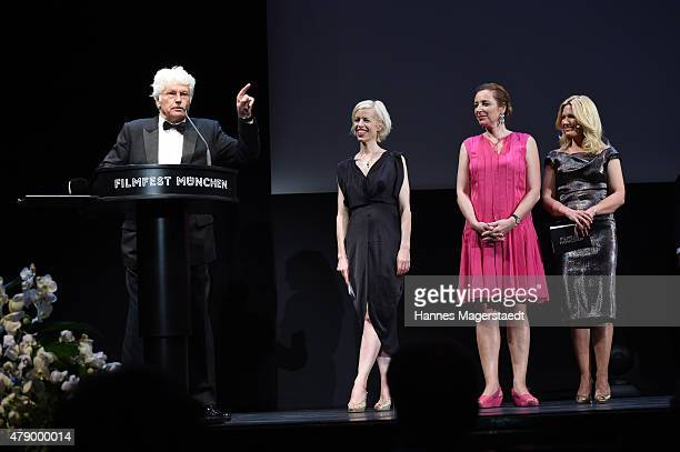 Jean-Jacques Annaud, Katja Eichinger; Diana Iljine and Jessica Kastrop attend the Cine Merit Award during the Munich Film Festival at Gasteig on June...