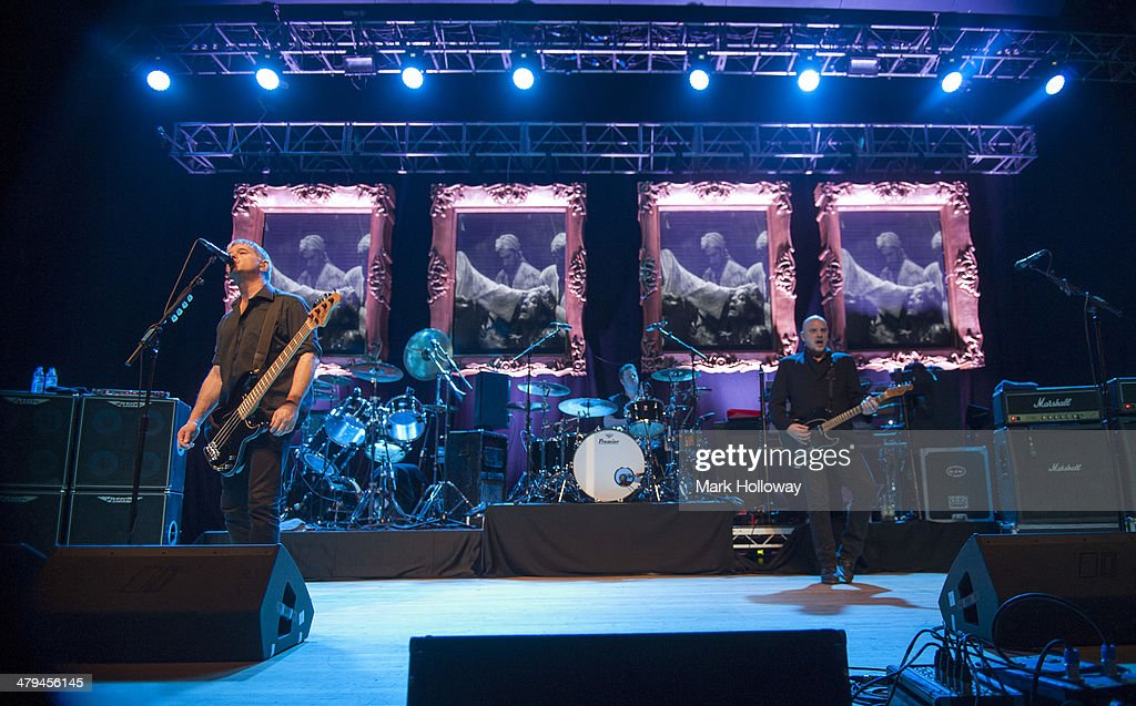 Jean-Jacques Burnel, Jim MacAulay and Baz Warne of The Stranglers performs on stage at Portsmouth Guildhall on March 18, 2014 in Portsmouth, United Kingdom.
