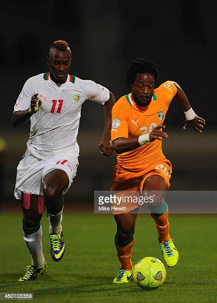 JeanJacques Gosso Gosso of Ivory Coast is challenged by Dame Ndoye of Senegal during the FIFA 2014 World Cup Qualifier Playoff Second Leg between...