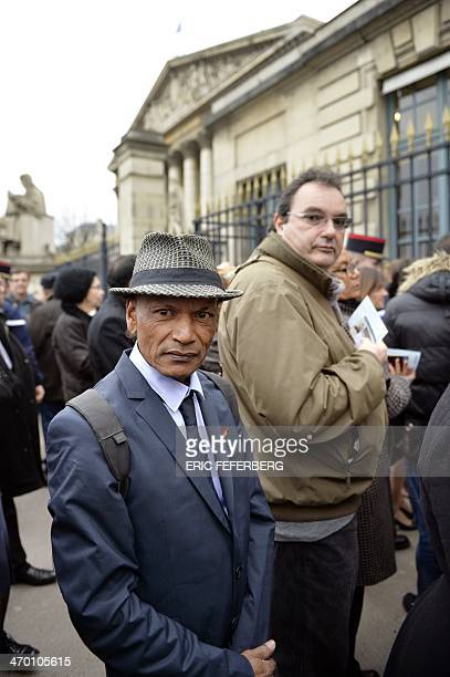 JeanJacques Martial stands on February 18 2014 outside the National Assembly in Paris on the day the Parliament is to debate a bill aimed at...