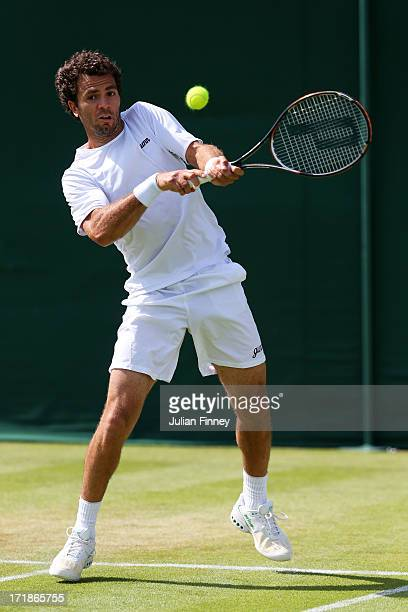 JeanJulien Roger of Netherlands plays a backhand during the Gentlemen's Doubles second round match between Aisam Qureshi of Pakistan and JeanJulien...
