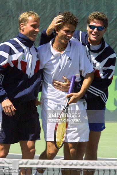JeanJulien Rojer is congratulated by Elmar Gerth and Kevin Jonckheer 11 February 2001 for winning a match for the Group II Davis Cup American Series...