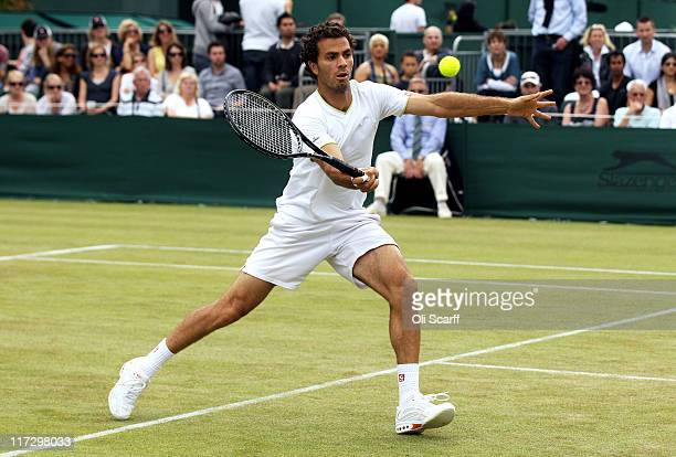 JeanJulien Rojer of Netherland Antilles in action while playing with Abigail Spears of the United States during their Mixed first round match against...