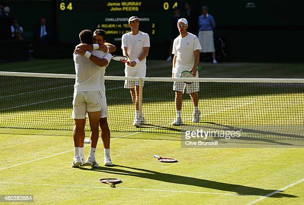 JeanJulien Rojer of Netherlands and Horia Tecau of Romania celebrate after winning the Final Of The Gentlemen's Doubles against John Peers of...