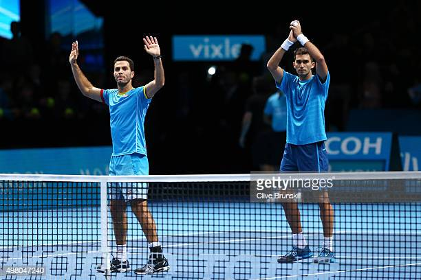 JeanJulien Rojer of Netherlands and Horia Tecau of Romania celebrate following their victory during the men's doubles match against Pierre Hugues...
