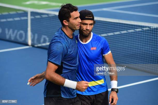 JeanJulien Rojer of Netherlands and Horia Tecau of Romania celebrate defeating Julio Peralta of Chile and Horacio Zeballos of Argentina after match...