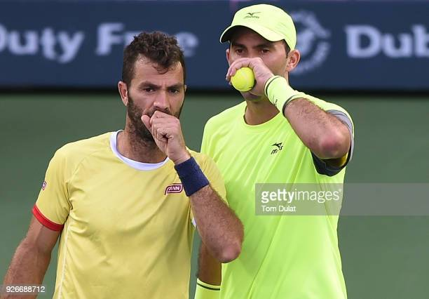 JeanJulien Rojer of Netherlands and Horia Tecau of Romania discuss tactics during their doubles final match against Jamie Cerretani of United States...