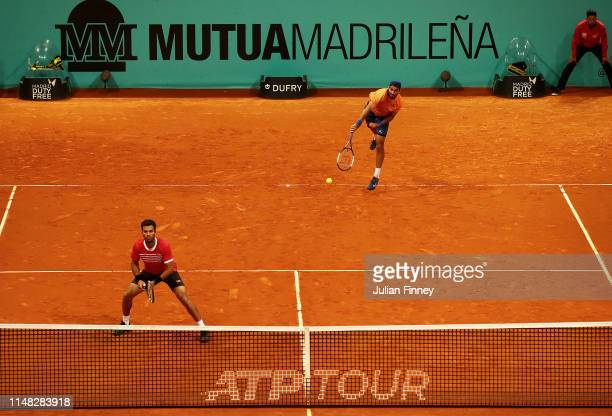 JeanJulien Rojer of Netherlands and Horia Tecau of Romania in action against Stefanos Tsitsipas of Greece and Wesley Koolhof of Netherlands in the...