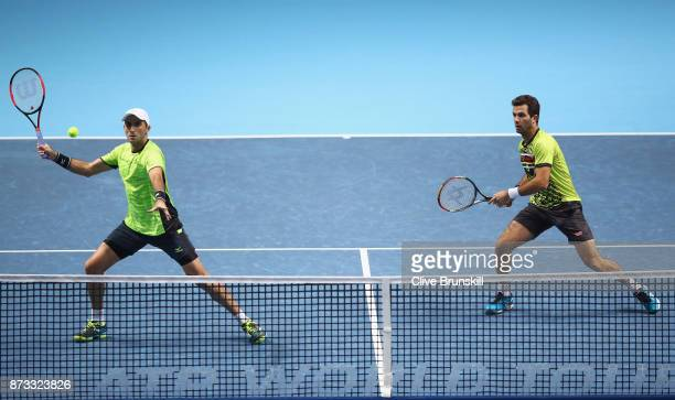 JeanJulien Rojer of Netherlands and Horia Tecau of Romania in action against PierreHughes Herbert and Nicolas Mahut of France in their first doubles...