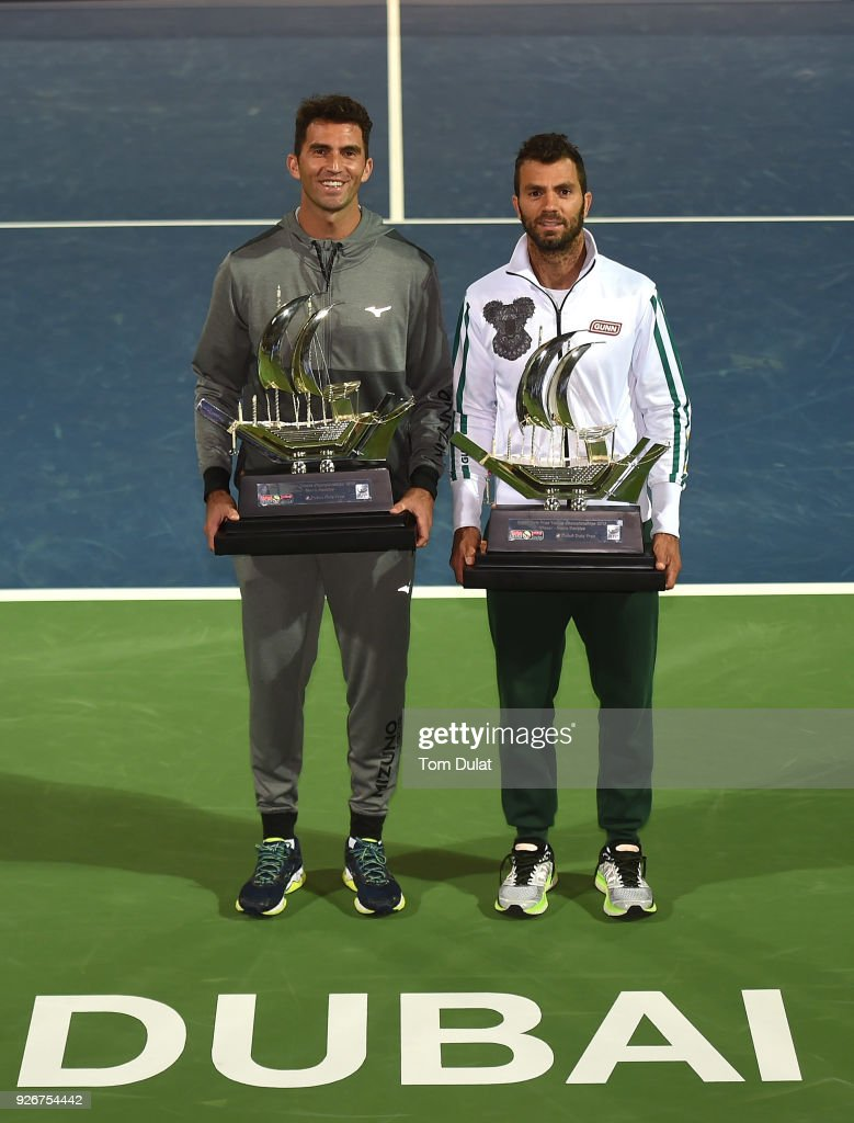 Jean-Julien Rojer of Netherlands and Horia Tecau of Romania poses with the trophies after winning their doubles final match against Jamie Cerretani of United States and Leander Paes of India on day six of the ATP Dubai Duty Free Tennis Championships at the Dubai Duty Free Stadium on March 3, 2018 in Dubai, United Arab Emirates