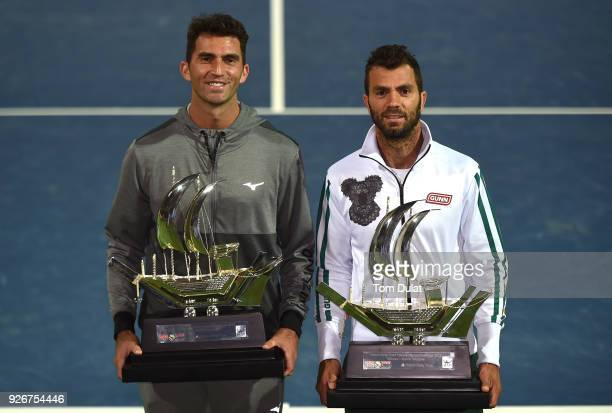 JeanJulien Rojer of Netherlands and Horia Tecau of Romania poses with the trophies after winning their doubles final match against Jamie Cerretani of...