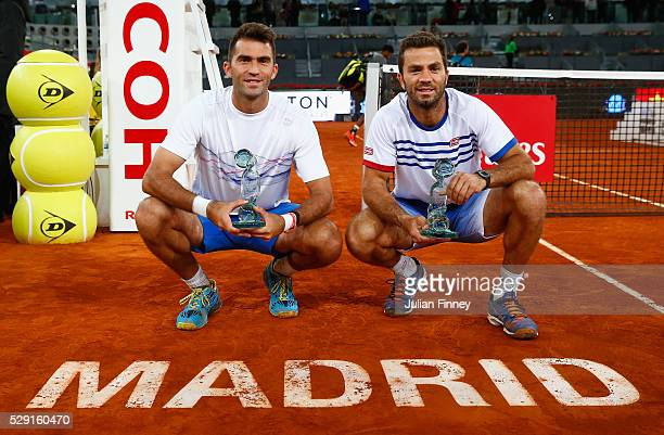 JeanJulien Rojer of Netherlands and Horia Tecau of Romania with the winners trophies after their win in the doubles final against Rohan Bopanna of...