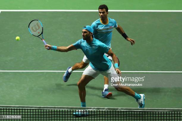 JeanJulien Rojer of the Netherlands and Horia Tecau of Romania in action against Jeremy Chardy of France and Henri Kontinen of Finland in their...