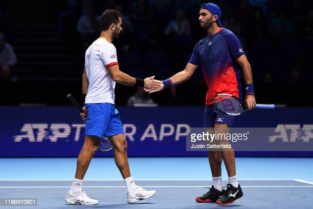 JeanJulien Rojer of The Netherlands and Horia Tecau of Romania celebrate in their doubles match against Kevin Krawietz of Germany and Andreas Mies of...