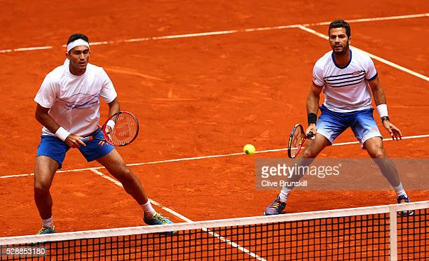 JeanJulien Rojer of the Netherlands and Horia Tecau of Romania in action against PierreHugues Herbert and Nicolas Mahut of France in their doubles...