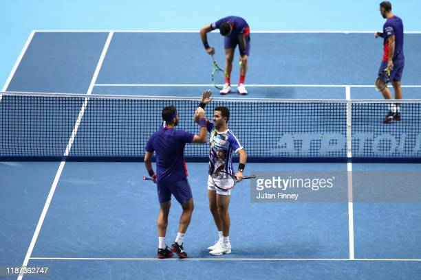 JeanJulien Rojer of The Netherlands and Horia Tecau of Romania celebrate match point in their doubles match against Juan Sebastian Cabal and Robert...