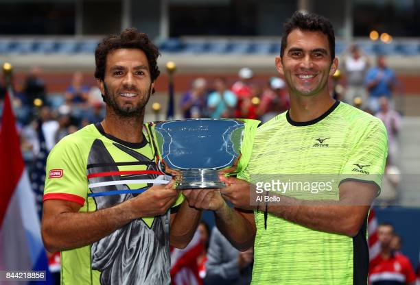 JeanJulien Rojer of the Netherlands and Horia Tecau of Romania pose with the trophy after defeating Feliciano Lopez and Marc Lopez of Spain during...