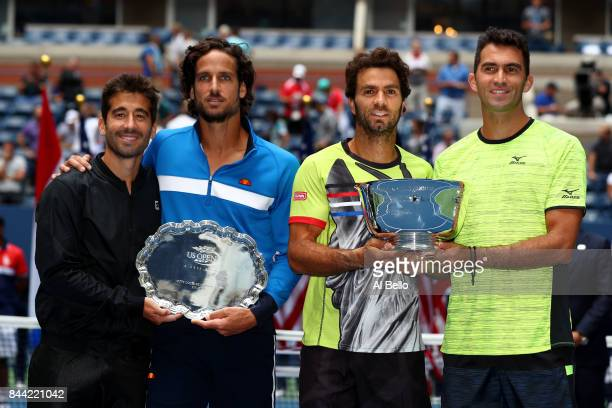 JeanJulien Rojer of the Netherlands and Horia Tecau of Romania pose with the championship trophy as runnerups Feliciano Lopez and Marc Lopez of Spain...
