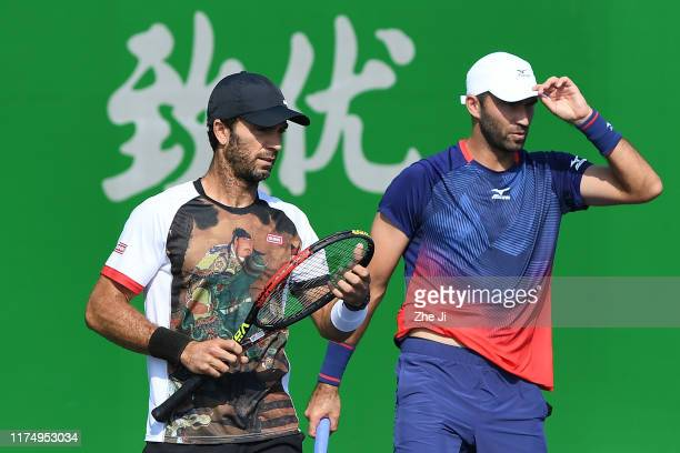JeanJulien Rojer of the Netherlands and Horia Tecau of Romania react during their Men's doubles second round match of 2019 Rolex Shanghai Masters...