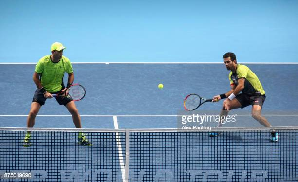 JeanJulien Rojer of The Netherlands and Horia Tecau of Romania return the ball during the doubles match against Ryan Harrison of The United States...