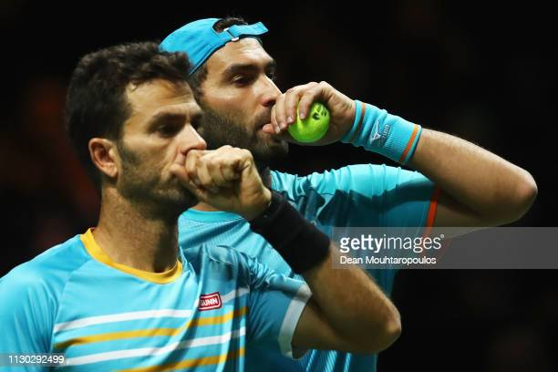 JeanJulien Rojer of the Netherlands and Horia Tecau of Romania speak between serves against Jeremy Chardy of France and Henri Kontinen of Finland in...
