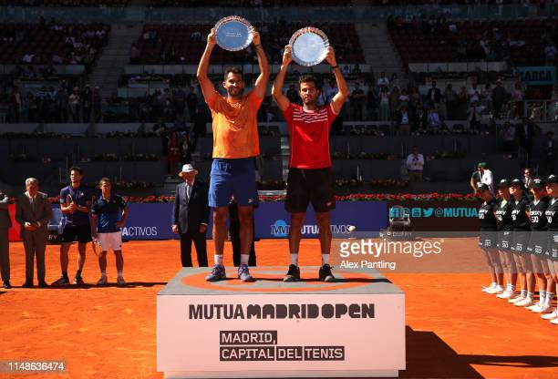 JeanJulien Rojer of The Netherlands and partner Horia Tecau of Romania celebrate victory with the trophies in their men's doubles final against Diego...