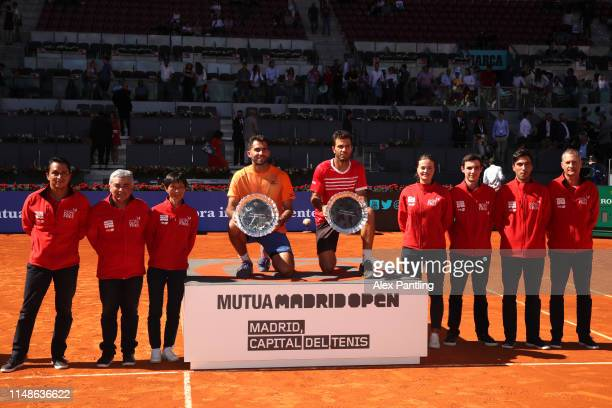 JeanJulien Rojer of The Netherlands and partner Horia Tecau of Romania celebrate victory with the trophies and the grounds staff in their men's...