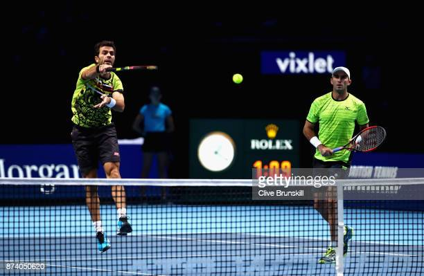 JeanJulien Rojer of The Netherlands partner of Horia Tecau of Romania returns the ball during the doubles match against Henri Kontinen of Finland and...