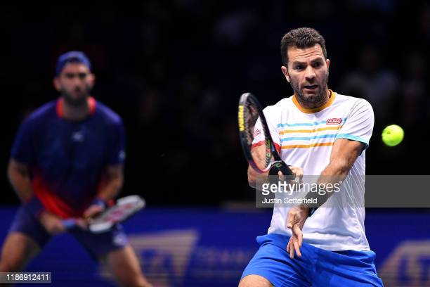 JeanJulien Rojer of The Netherlands playing partner of Horia Tecau of Romania plays a forehand in their doubles match against Kevin Krawietz of...
