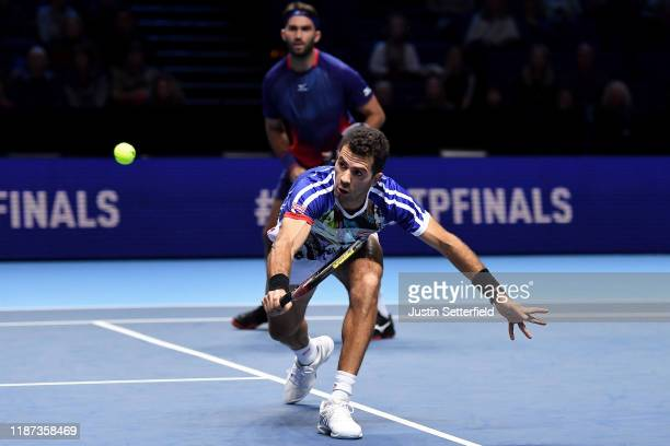 JeanJulien Rojer of The Netherlands playing partner of Horia Tecau of Romania plays a backhand in their doubles match against Juan Sebastian Cabal...