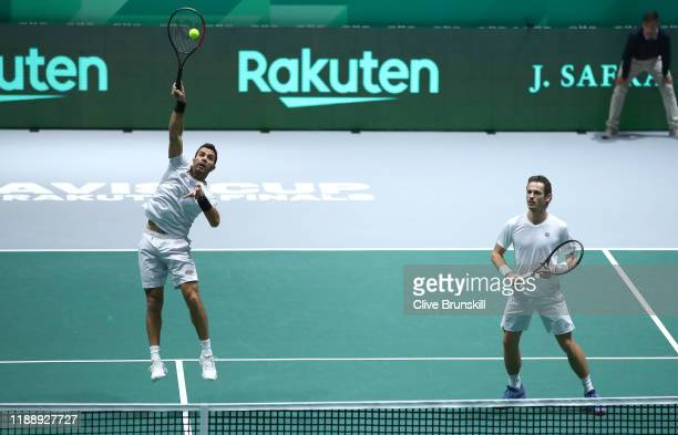 Jean-Julien Rojer of the Netherlands volleys the ball as his player partner Wesley Koolhof looks during their Davis Cup Group Stage match against...