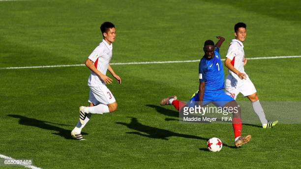 JeanKevin Augustin of France scores his teams third goal with pressure from Tan Sinh Huynh and Dinh Trong Tran of Vietnam during the FIFA U20 World...