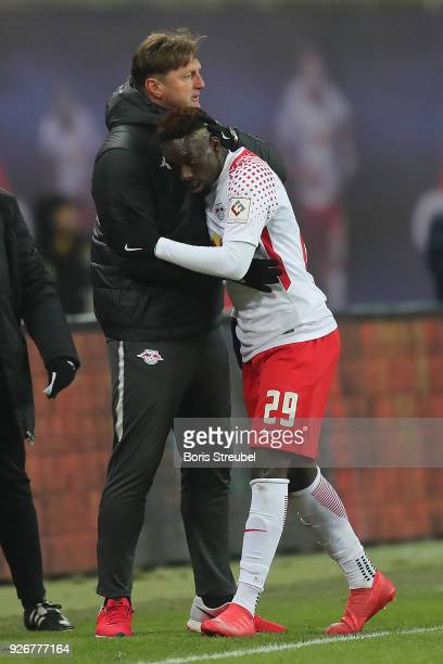 JeanKevin Augustin of Leipzig is huge by coach Ralph Hasenhuettl of Leipzig as he is being substituted and comes of during the Bundesliga match...