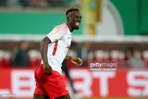 JeanKevin Augustin of Leipzig reacts during the DFB Cup round 2 match between RB Leipzig and Bayern Muenchen at Red Bull Arena on October 25 2017 in...